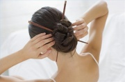 http://www.ehow.com/how_2191786_use-chopsticks-style-hair.html